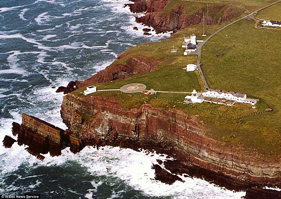 Clifftop: The five properties can be seen, right, next to a helicopter launch pad and a lighthouse which is now unoccupied