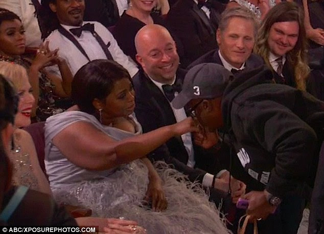 Front-row stars: Among the women who Coe kissed on the hand were Octavia Spencer, who was nominated for best supporting actress for Hidden Fences