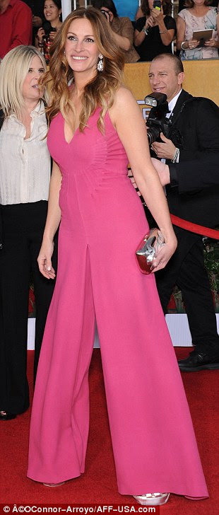 Surprise! Julia Roberts' pink outfit actually turned out to be a Valentino jumpsuit, which she teamed with silver YSL heels, a matching Roger Vivier clutch and Wilfredo Rosado earrings