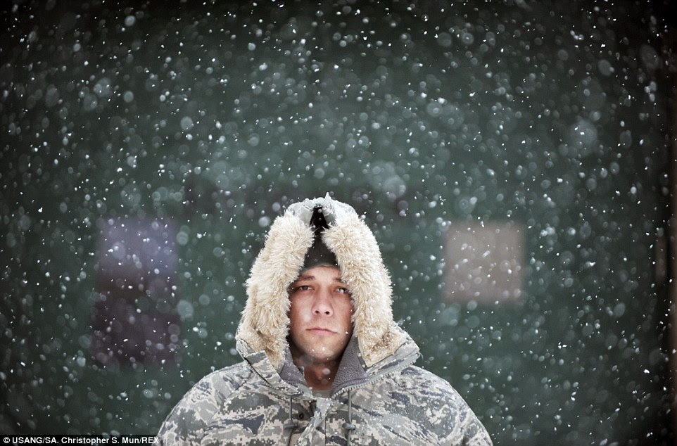 Reflection: Senior Airman Jonathan E Mazura pauses for a moment outside during a major snowstorm in Westhampton Beach, New York, Mazura is assigned to the 106th Rescue Wing