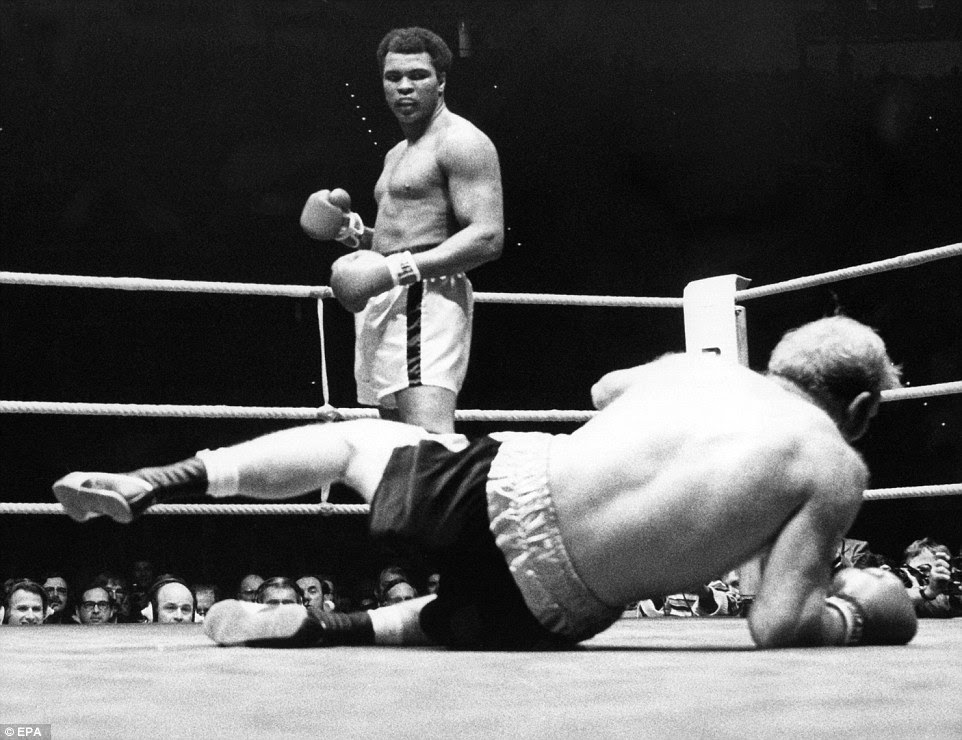 Muhammad Ali knocks out British challenger Richard Dunn in the fifth round of their fight in Munich in May 1976