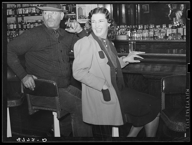 Man and girl at the bar. Saloon in North Platte, Nebraska