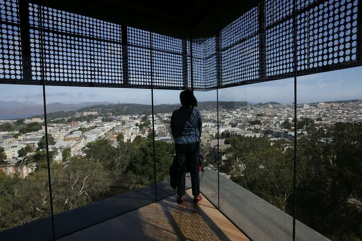 A visitor takes in the view from the top of Hamon Tower at the deYoung Museum on Tuesday, September 15, 2015 in San Francisco, Calif.