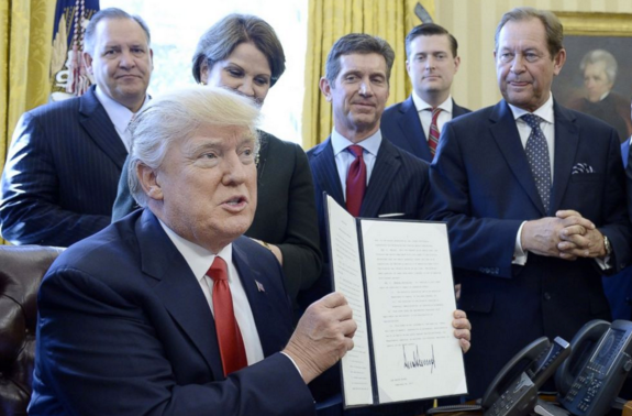 "President Trump signs executive order to eliminate ""job-killing regulations"" on Feb. 24, 2017."