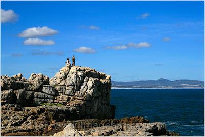 Tourists enjoying view of Walker Bay, South Africa