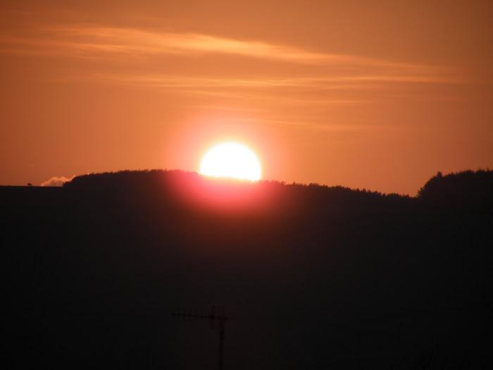 sun setting over the island