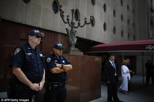NYPD cops stand guard outside Eli Wiesel's funeral at the Fifth Avenue Synagogue