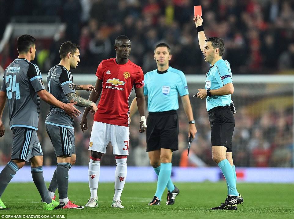 Bailly (centre) and  Roncaglia (2nd left) are both shown red cards by Romanian referee Ovidiu Hategan (right)