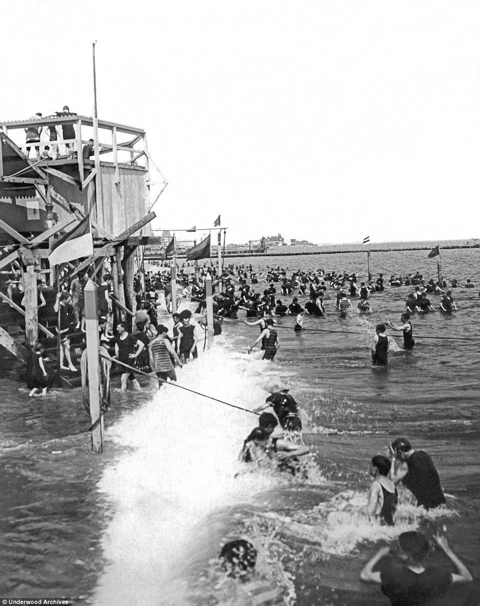 Cling on tight: Ropes helped bathers from drifting far into the sea and helped guide them back to the steps (circa 1900)