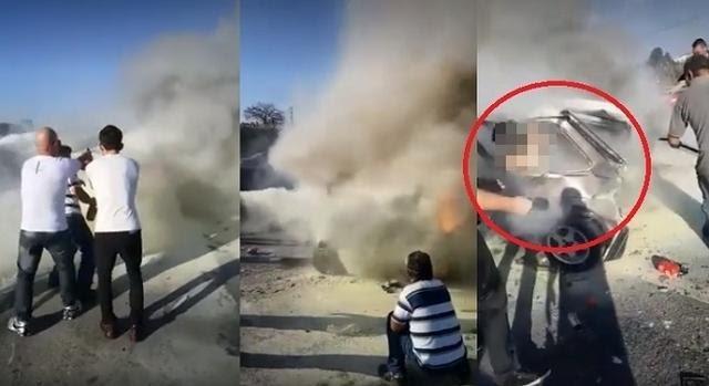 VÍDEO FORTE: Mulher em chamas fica presa em ferragens após acidente