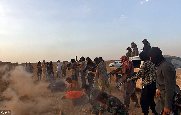 Slaughter: A separate image showed masked gunmen preparing to shoot seven men from the same air base. The chilling photograph was released by the Raqqa Media Center yesterday and tallies with other reporting