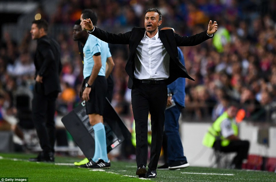 Barcelona boss Luis Enrique tries to urge on his team as his team were pegged back by Atletico in the second half