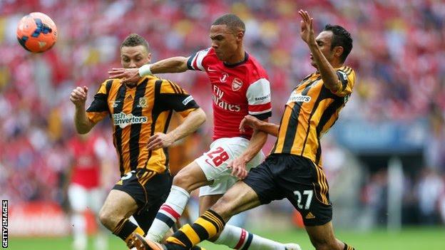 Kieran Gibbs is tackled