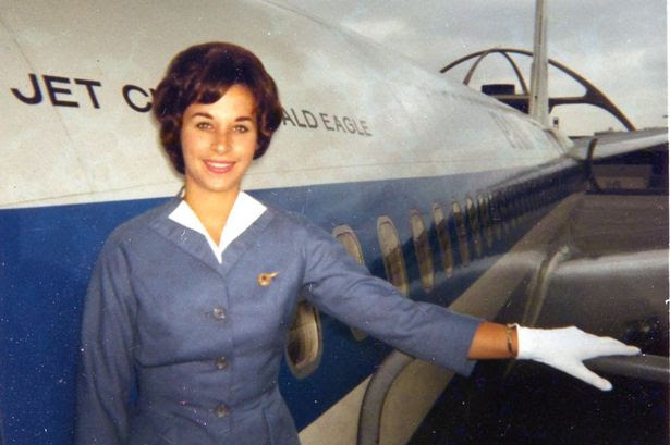 Pan Am - Betty Riegel in LA welcoming first class passengers