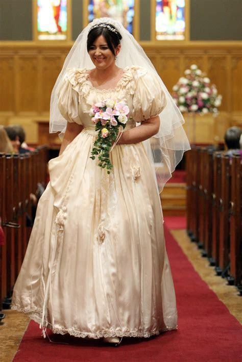Stephanie wearing the wedding dress of Elaine Molyneaux