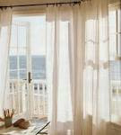 Lovely Creamy Blinds And Curtains Together Covering Door Windows ...