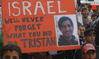 Protestors hold up a poster of Tristan Anderson  who was injured by Israel troops last week