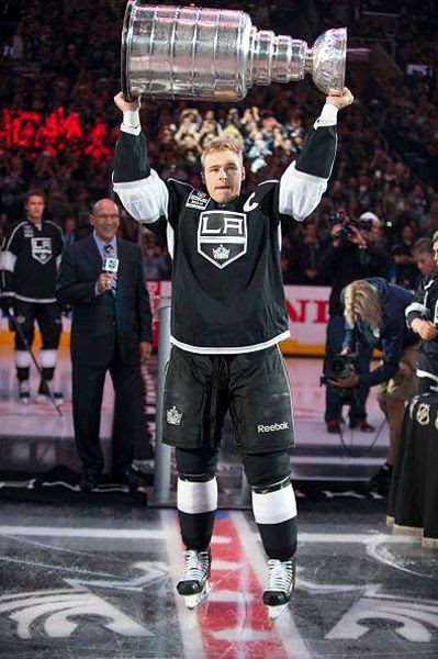 Team captain Dustin Brown shows off the Stanley Cup trophy to the STAPLES Center crowd during the L.A. Kings' opening game ceremony, on October 8, 2014.