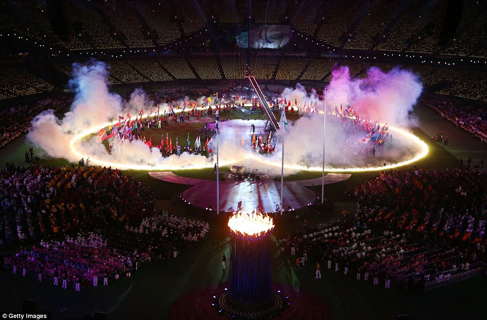 Smoke and light: Hundreds of flares created a stunning vista inside the Olympic Stadium as the flags of all the Paralympic nations were paraded in the arena