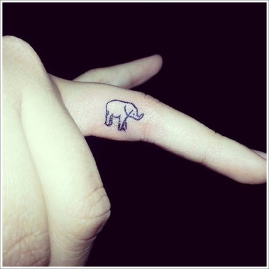 Tiny Elephant Tattoo On Finger