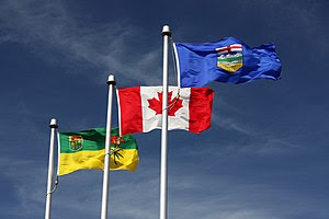 From left to right, the flags of Saskatchewan,...