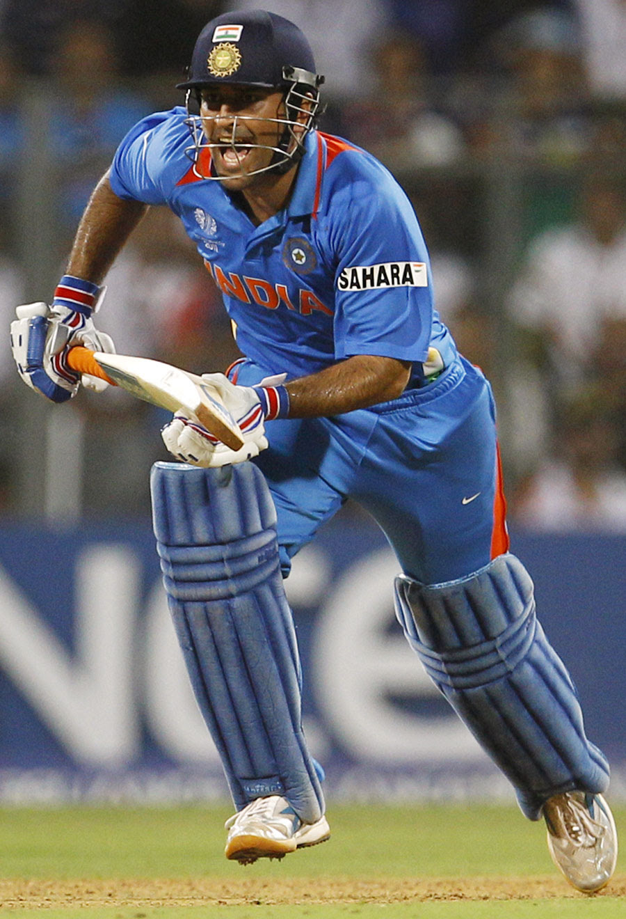 MS Dhoni scampers between the wickets