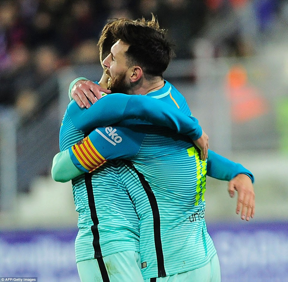 Suarez is congratulated by team-mate  Messi after scoring the opening goal of the La Liga match