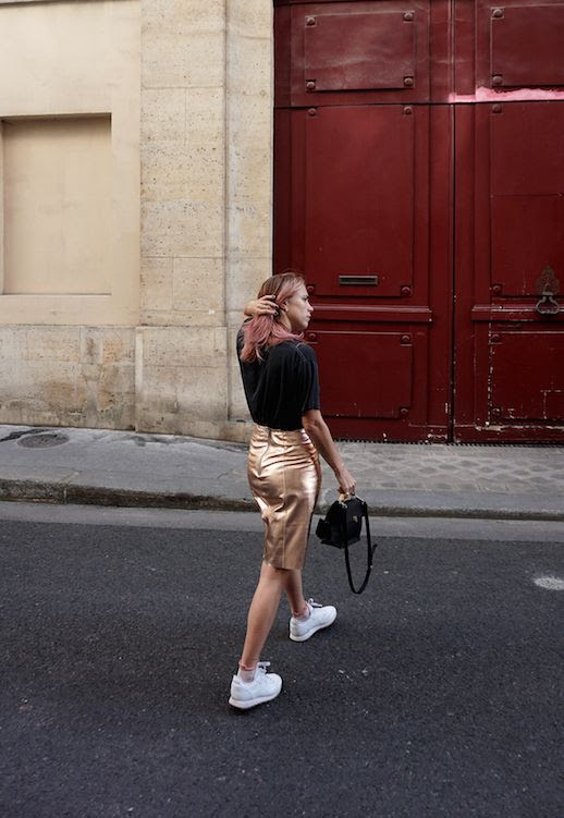 Le Fashion Blog Courtney Trop Graphic T Shirt Rose Gold Skirt White Sneakers Black Bag Via Always Judging