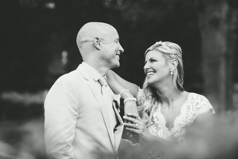 Couple's portraits with a bride and groom following a small backyard wedding ceremony in Rockford IL. Photo by Mindy Joy Photography