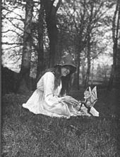 The second of the five photographs, showing Elsie with a winged gnome