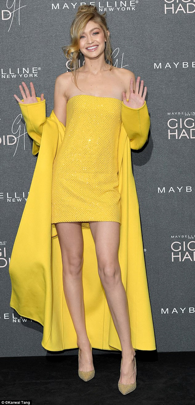 Showcasing her model legs: The Malibu-born socialite added height with a vertiginous pair of gold sparkling courts