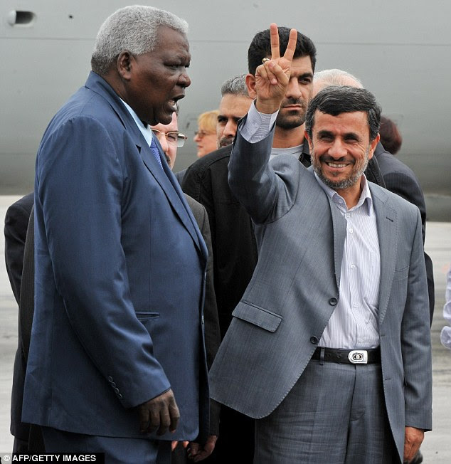 V for victory: Mahmoud Ahmadinejad arrives in Havana today to deliver a speech to students and for a meeting with Cuban President Raul Castro