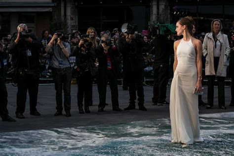 Emma Watson in a white dress at London premiere of Noah