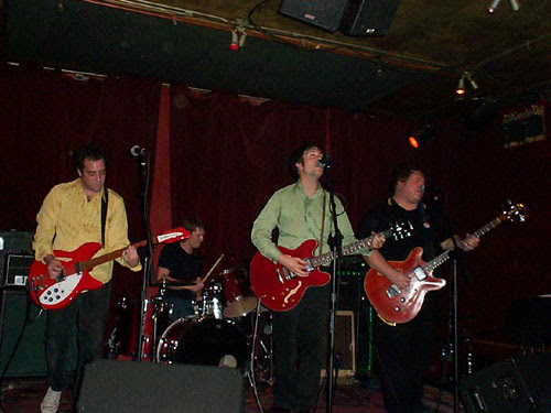 The Pills with red guitars; playing tonight at TT's