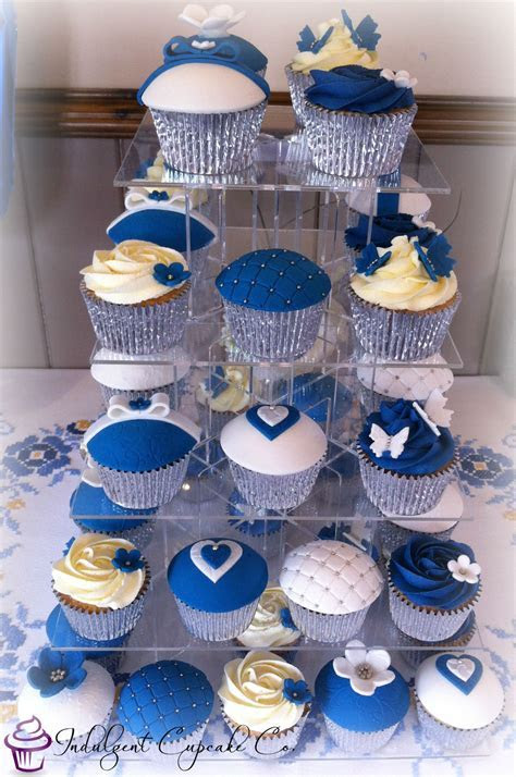 Royal blue, white & silver wedding anniversary cupcakes