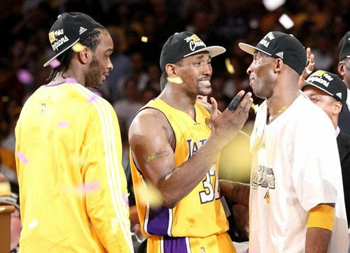 Ron Artest and Kobe Bryant congratulate each other as Josh Powell looks on...after the Lakers defeated the Boston Celtics, 83-79, in Game 7 of the NBA Finals.