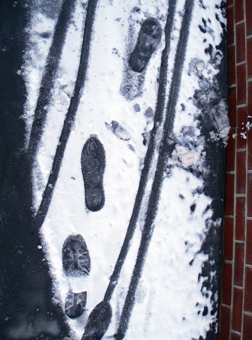 footprints and cart tracks in snow