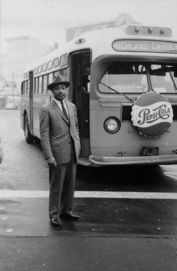 American Civil Rights leader Reverend Martin Luther King Jr.(1929 - 1968) stands in front of a bus at the end of the Montgomery bus boycott, Montgomery, Alabama, December 26, 1956. (Photo by Don Cravens/The LIFE Images Collection/Getty Images)