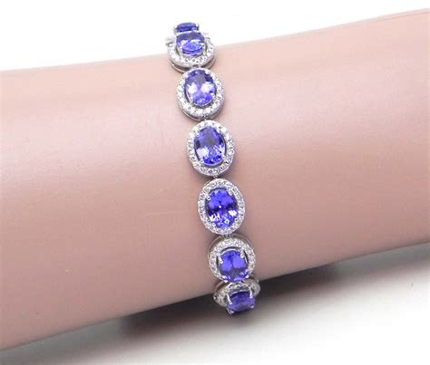 ladies  white gold  tanzanite diamonds oval link