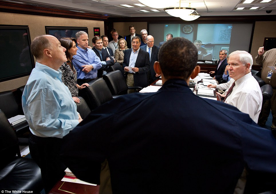 Taking command: President Obama talks with members of the national security team in the White House situtation room following the conclusion of the mission