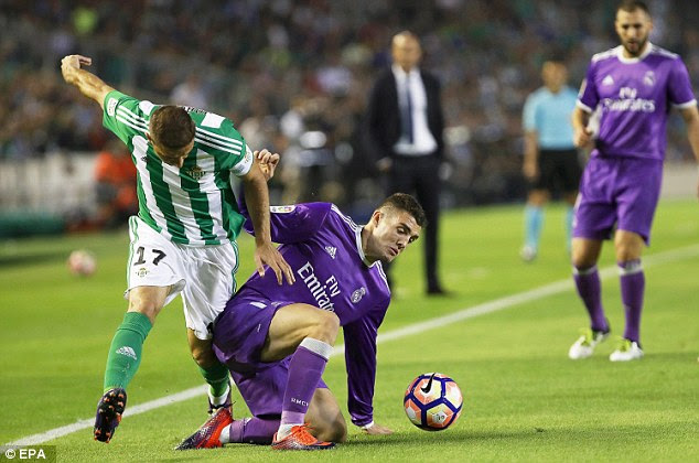 Mateo Kovacic of Madrid goes to ground to take the ball off Betis' Joaquin Sanchez