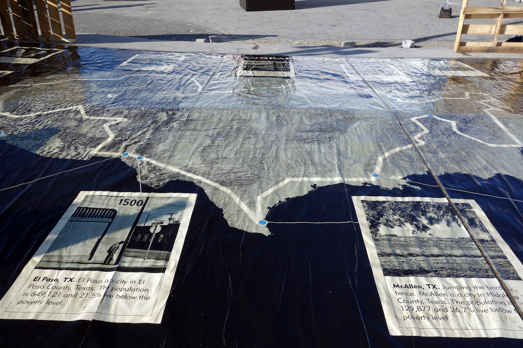 A map of 'Geography of Poverty' installed at Photoville in Brooklyn Bridge Park (photo by the author for Hyperallergic)