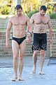 hugh jackman hits the beach with his speedo clad trainer 01