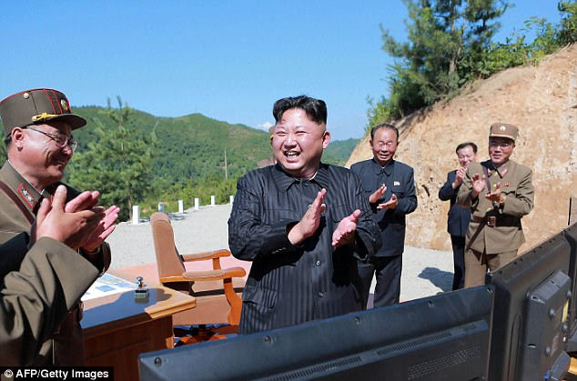 State-run news agency Korean Central News Agency (KCNA) reported that North Korea has threatened a 'merciless' nuclear strike 'at the heart of the US' if Kim Jong-Un's regime is threatened by America. Kim is pictured on July 4 after the test-launched of the Hwasong-14 ICBM