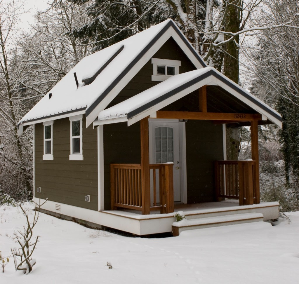 The Tiny House Movement Part 1 - Small Modern House Design With White Walol Using Large Window AndWooden Brown Color That Have
