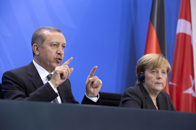 FILE - In this Feb. 4, 2014 file photo German Chancellor Angela Merkel, right,  listens  as Turkey's Prime Minister Recep Tayyip Erdogan, left,  speaks  duri...