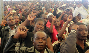 Thousands of Zimbabweans gather at Mt. Carmel High School to oppose the ongoing sanctions against the Southern African state. Sanctions were imposed after land seizure that restored property to the rightful owners. by Pan-African News Wire File Photos