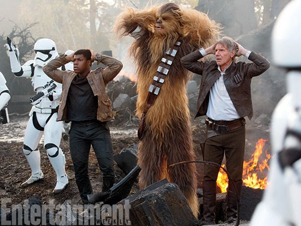 Finn, Chewbacca (Peter Mayhew) and Han Solo (Harrison Ford) are held captive by First Order Stormtroopers in STAR WARS: THE FORCE AWAKENS.