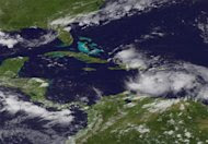 Tropical Storm Isaac is seen in the Caribbean on August 23, 2012. REUTERS/NOAA