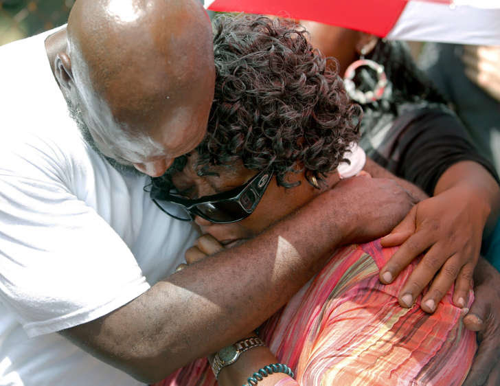 Judy Scott is comforted Thursday, July 9, 2015, by Alfred Smalls at the site in North Charleston, S.C., where her son, Walter Scott, was shot and killed by North Charleston police officer Michael Slager on April 4.